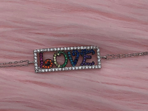 Sterling Silver Bracelet.  Bar Bracelet with Love inside bar.   Bar is cz's and LOVE is in colored cz's