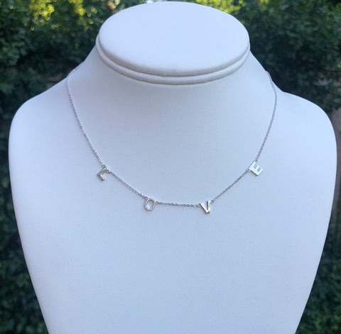 "16 inch sterling silver necklace with extenders.    Necklace has dangling letters spelling out LOVE.   The ""O"" has cz stones."