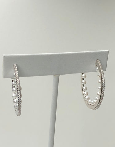 Sterling silver hoop with cz's on the outside and simulated pearls on the inside.