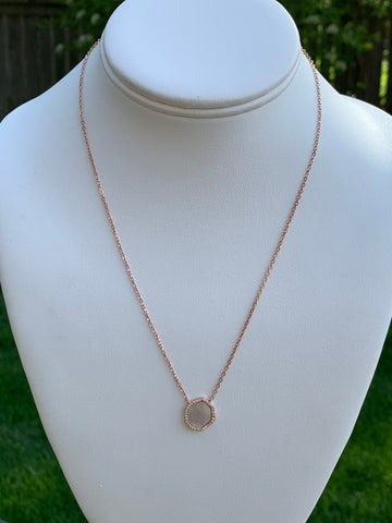 Mother of pearl and cubic zirconia oval necklace.   Necklace is rose gold over sterling silver.