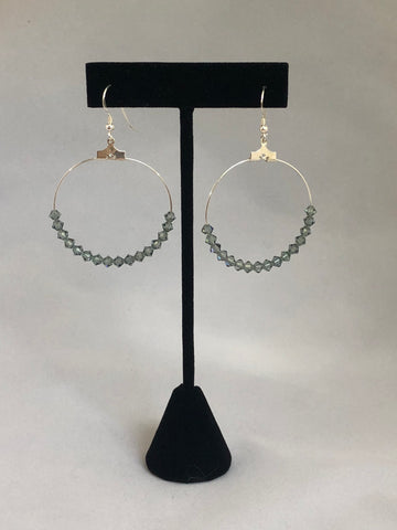 Handmade sterling silver hoop earring.   Indian Sapphire - colored Swarovski crystals in the hoop.