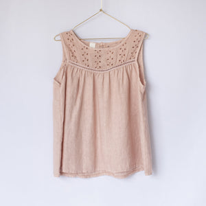 Rose pink sleeveless linen blouse with broderie Anglaise detail on hanger