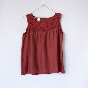 Terra (red) sleeveless linen blouse with broderie Anglaise detail on hanger