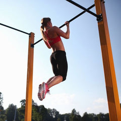 Fitness model performing Chin Ups on Bar