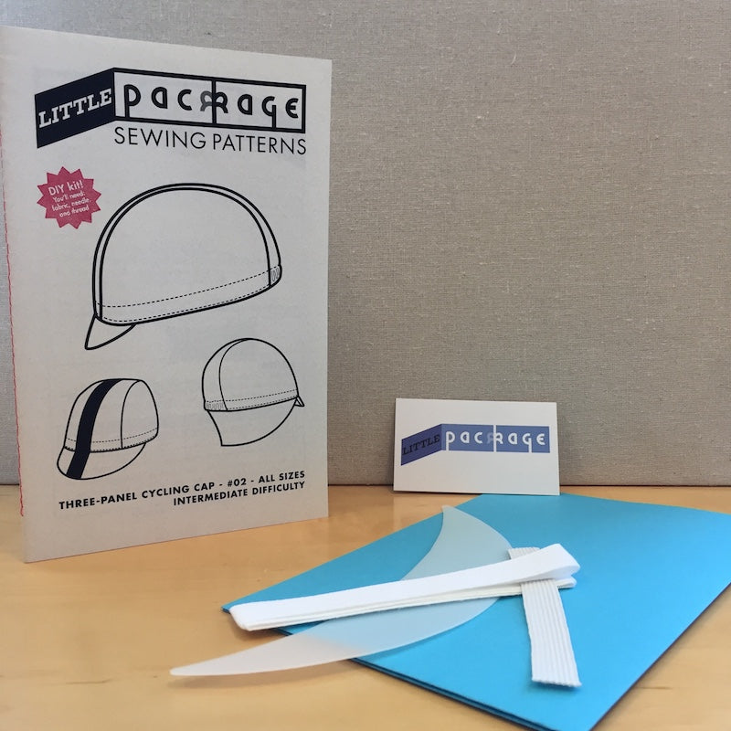 Microcosm Publishing - Little Package Cycling Cap - Caroline P