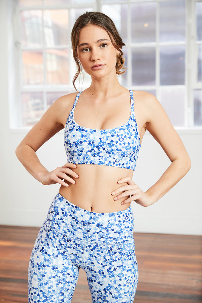 blue Moroccan tile inspired yoga bra with classic scoop neckline