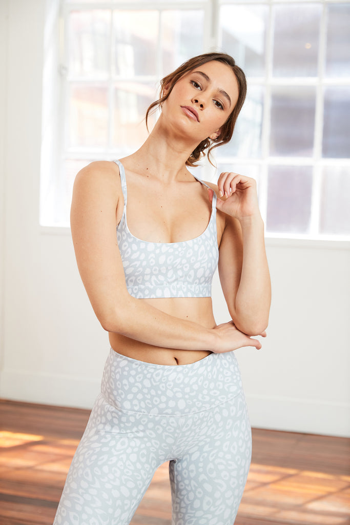 light grey leopard print sports bra with a classic scoop neckline