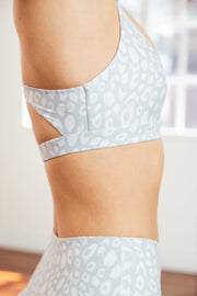 sophisticated leopard print yoga bra with a white embroidered logo