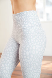 light grey high-rise yoga pant with a white embroidered logo