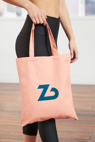 peach coloured cotton canvas tote bag with the Zenbody logo