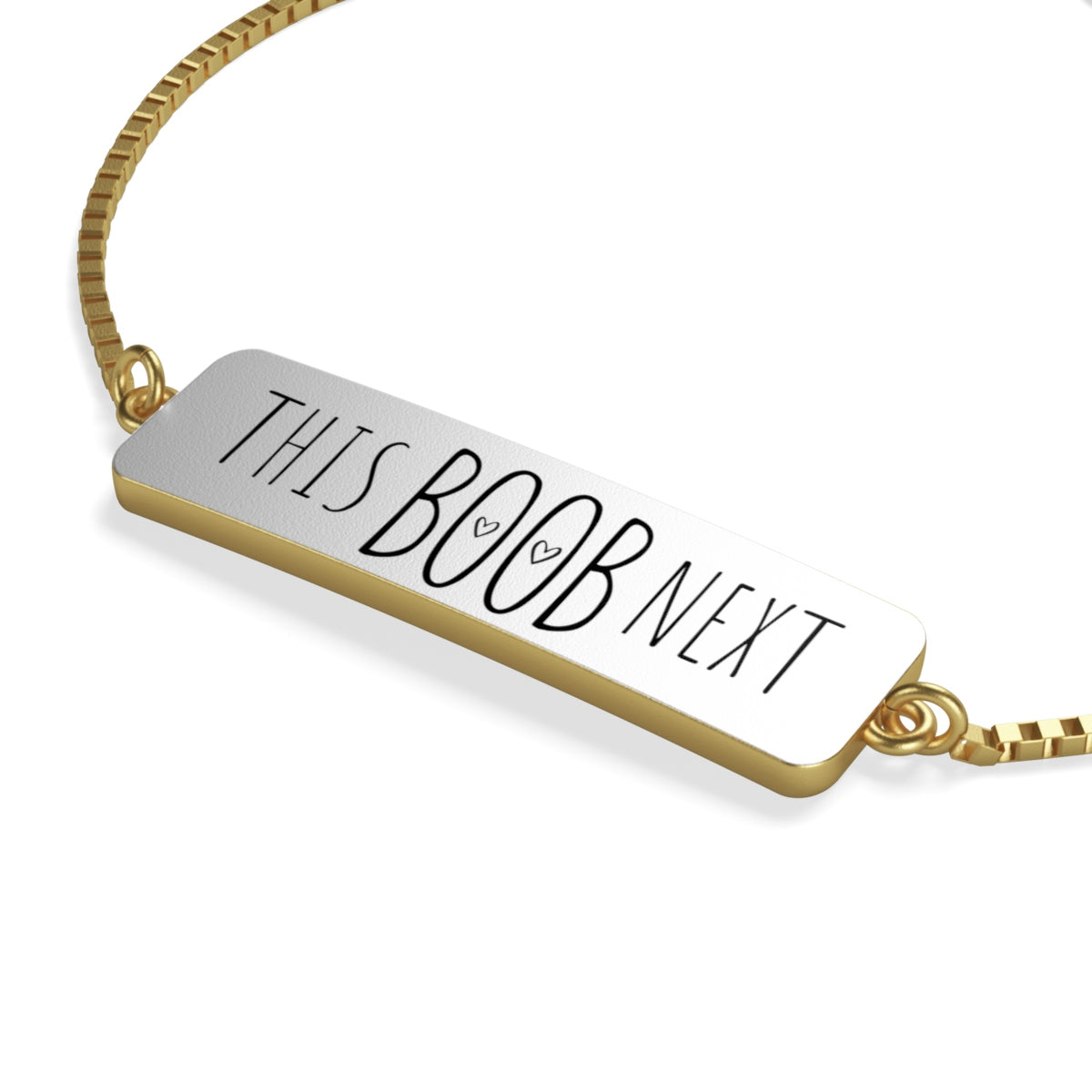 Breastfeeding reminder bracelet in gold with a rectangle pendant shape and sliding closure.