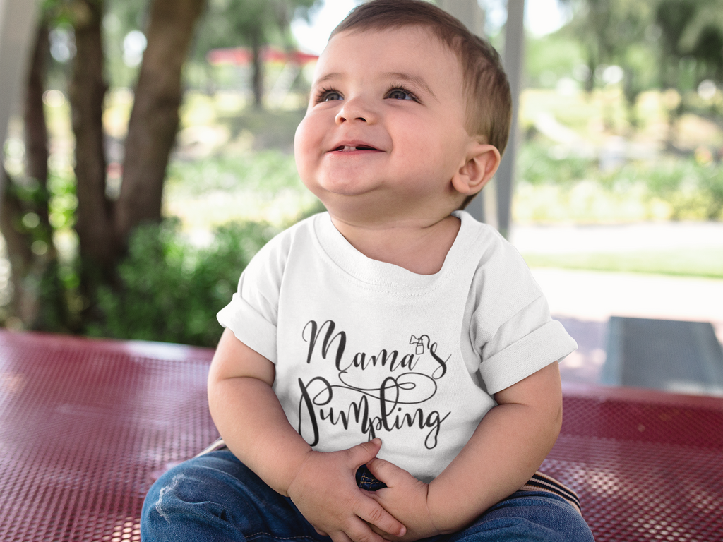 "Toddler baby wearing a breastfed toddler t-shirt that says ""Mama's Pumpling""."