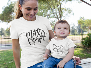 Breast pumping mom wearing a pumping mom's graphic t-shirt that says mother pumper.