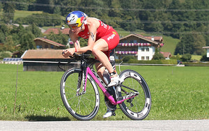 woman bike racer triathlon bike