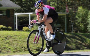female triathlon bike racer