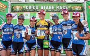 female bicycle race team podium water bottle