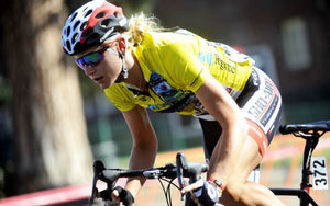 female bike race in yellow jersey