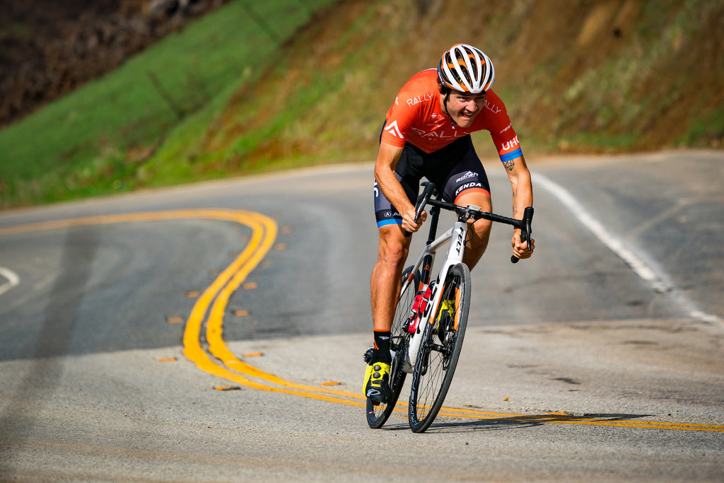 cyclist descending curved road