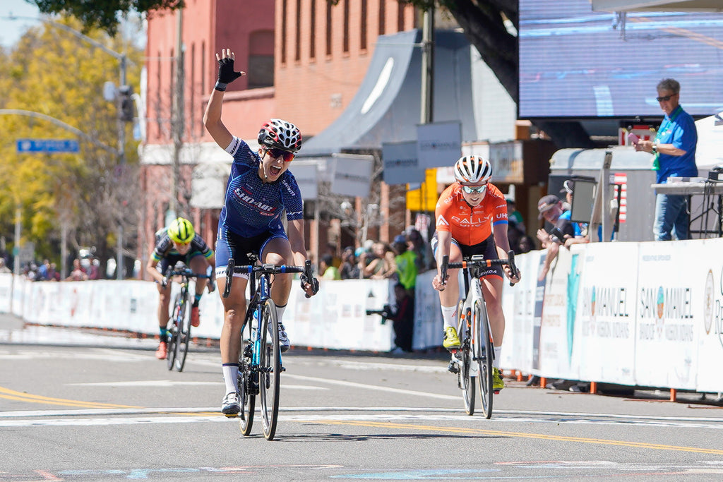 women bike race win