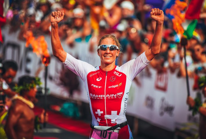 female triathlete finish line triathlon hawaii