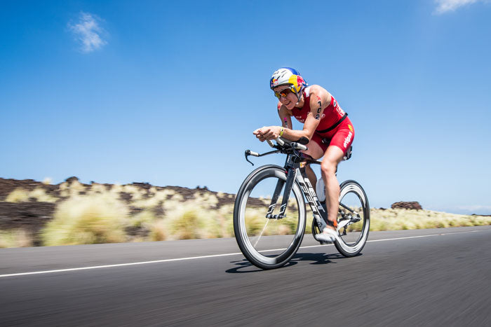 female triathlete on bike