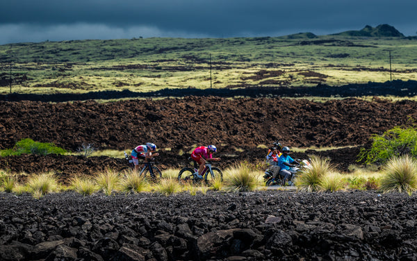 women triathletes racing bikes Kona