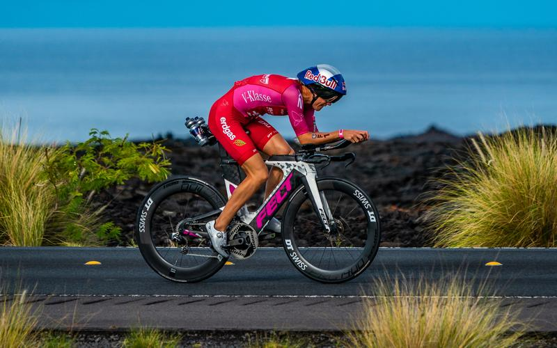 woman triathlete on bike kona hawaii