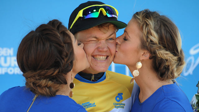 bike racer yellow jersey podium girls kiss