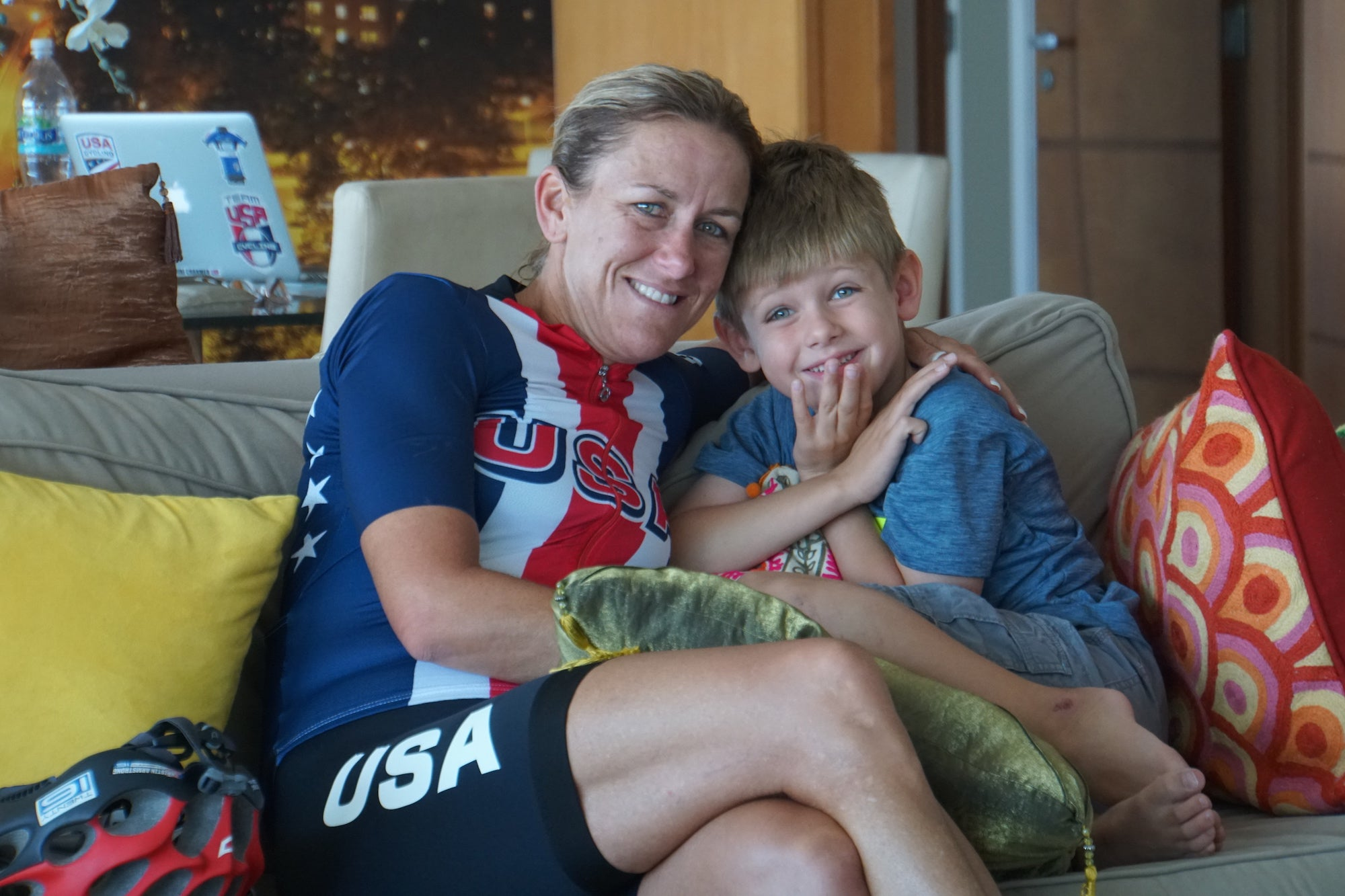 USA woman bike racer with son