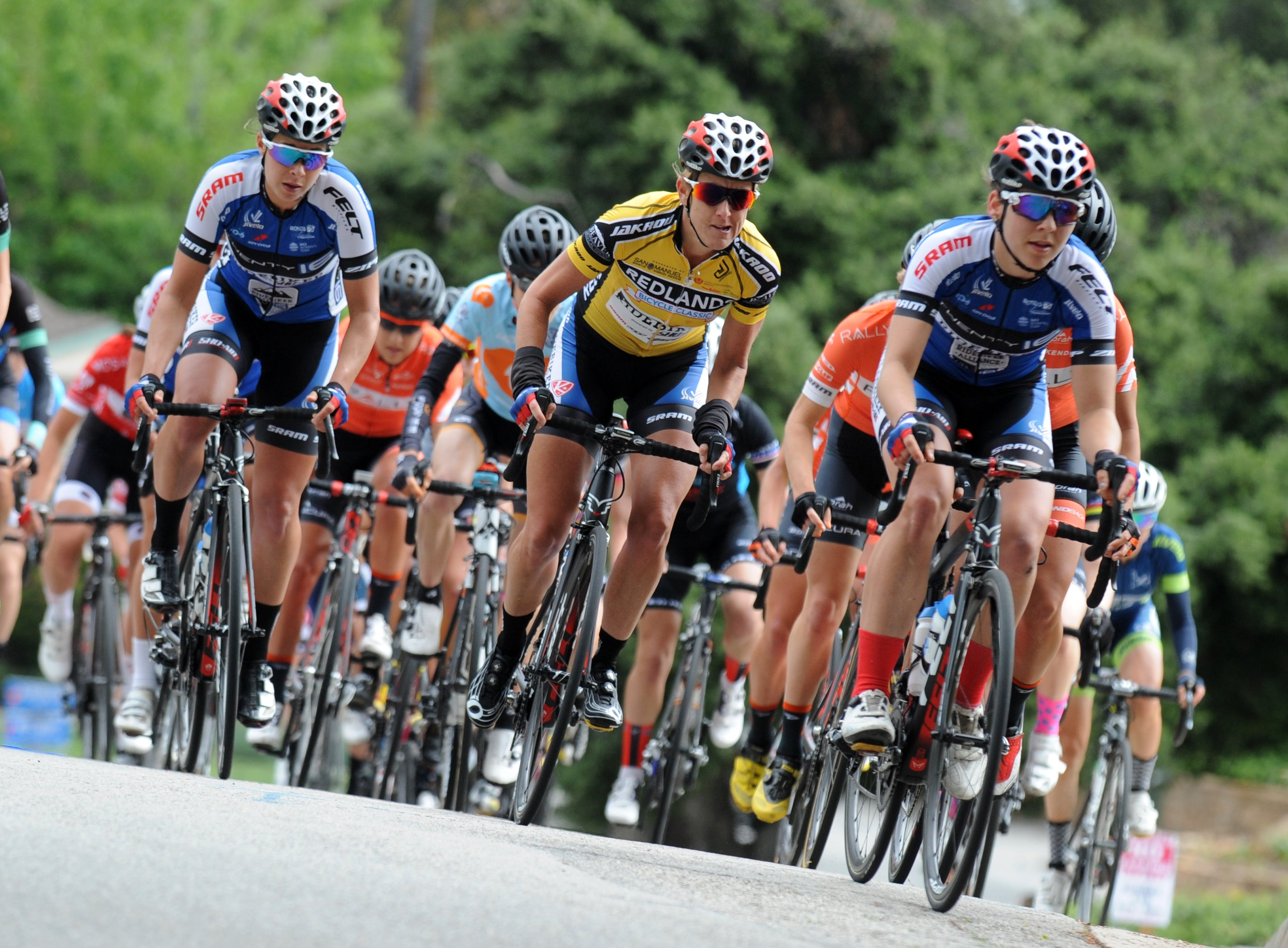 women bike riders race in cycling event