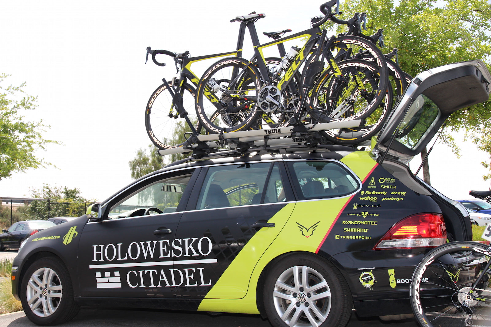 bicycles on top of team car race