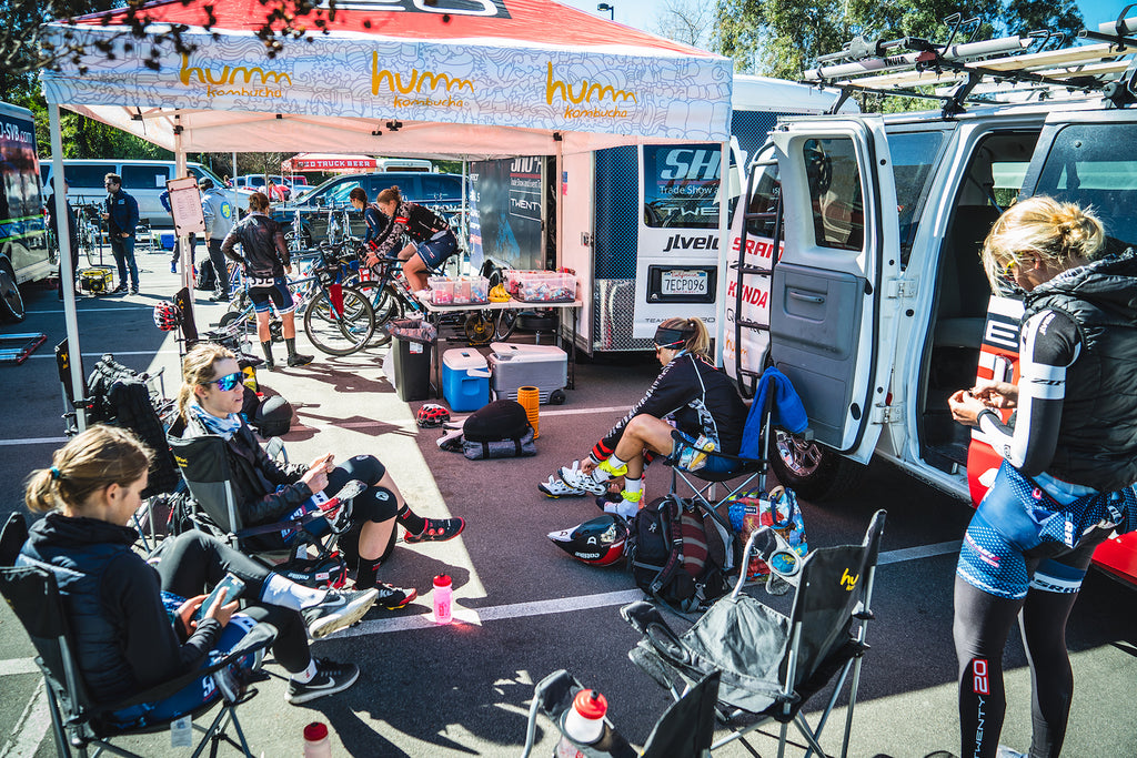 women bike racing pits