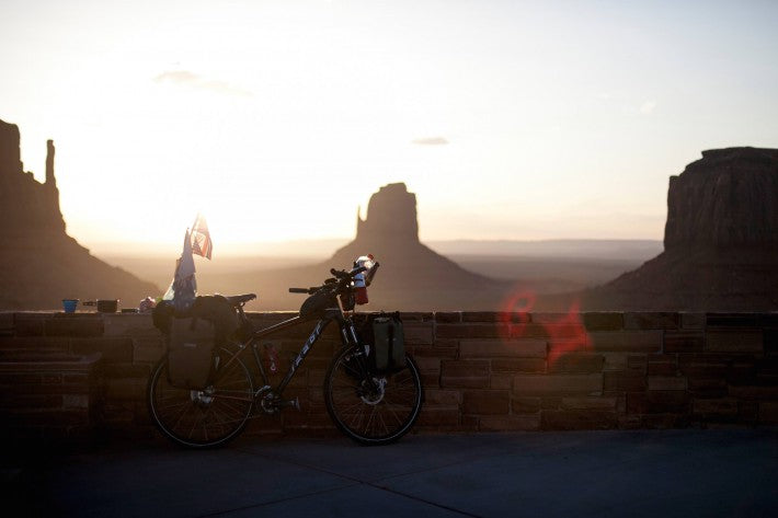 bicycle sunset monument valley desert