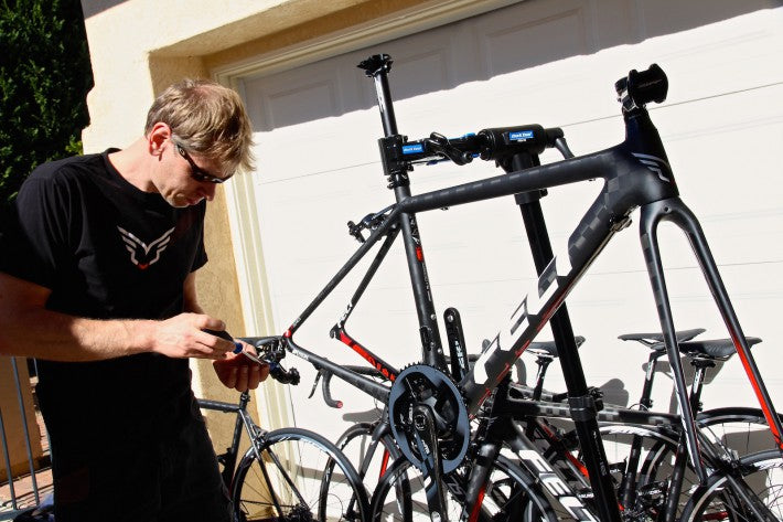 bicycle mechanic working on road bike