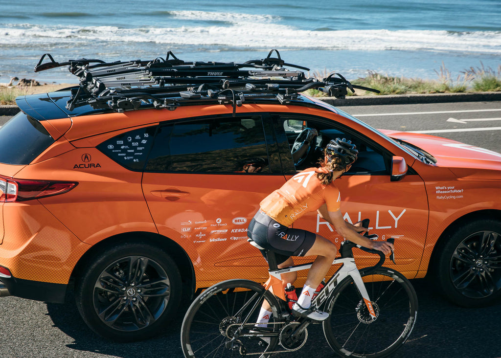 female cyclist car