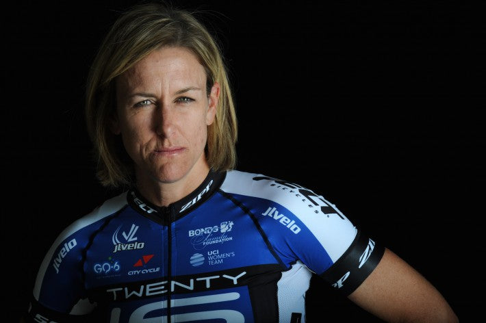 female bike racer in blue jersey