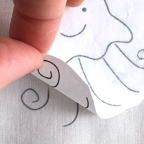 Carefully peel your embroidery transfer pattern to make sure the ink has transferred to your sewing fabric