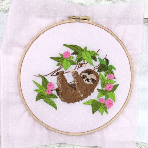 Embroidery and white felt in the hoop
