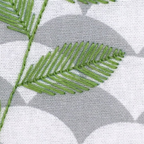 close up of embroidered leaf stitched with fly stitch