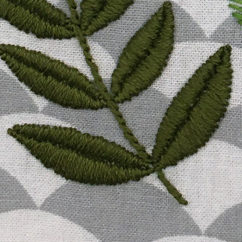 close up of satin stitched leaves