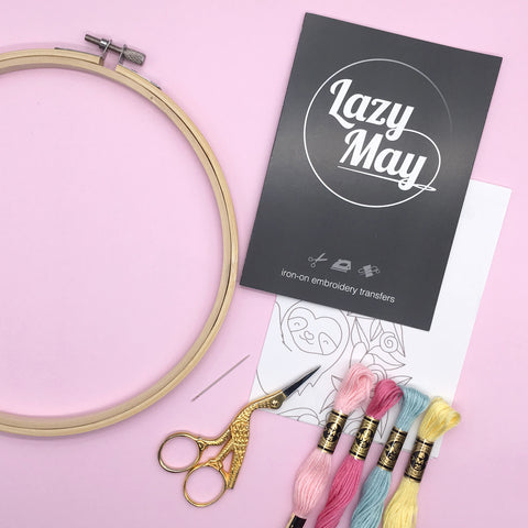 embroidery equipment, thread, hoop, needle and a pack of Lazy May Iron on embroidery transfer patterns