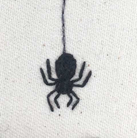 Close up of embroidered spider in halloween embroidery design
