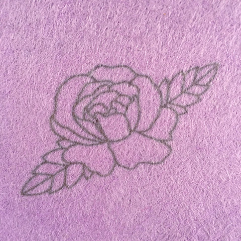 Lazy May Iron on rose embroidery transfer applied to light purple wool felt