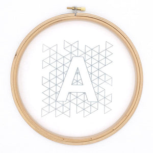 modern iron on embroidery pattern transferred to white fabric, geometric alphabet design