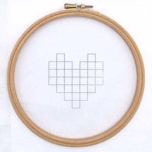 Geometric heart shape iron on embroidery design transferred on to fabric. Modern embroidery pattern