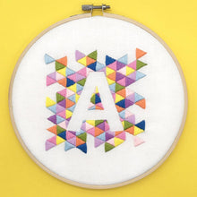 Load image into Gallery viewer, Geometric monogram modern hand embroidery pattern, colourful triangles around the letter A