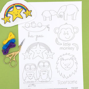 Embroidery transfers sheet featuring designs for children's clothes and textiles, including a lion, monkey, owls, stars, elephants