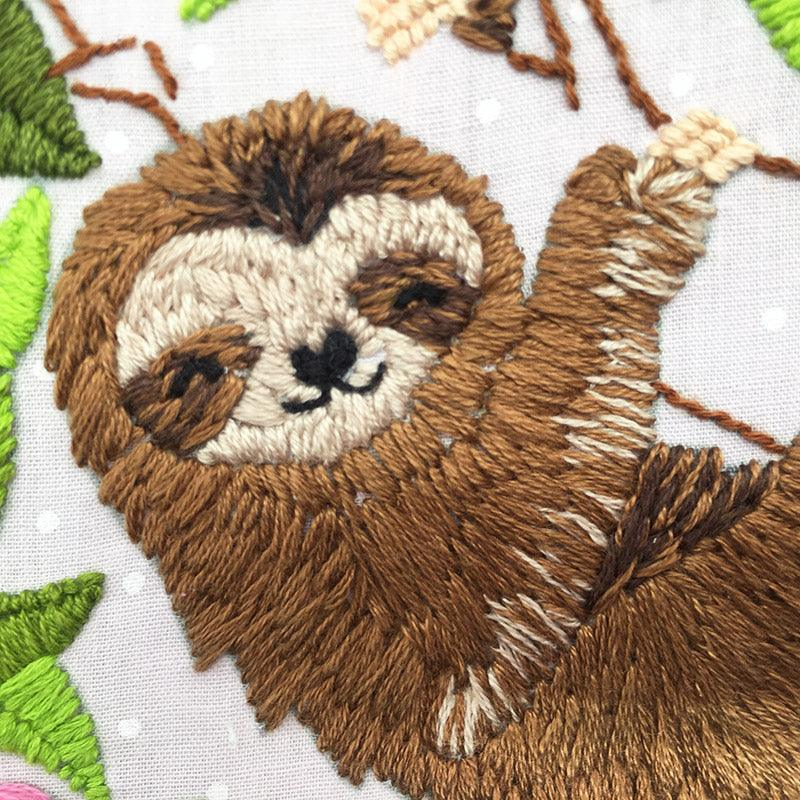 close up of hand embroidered sloth