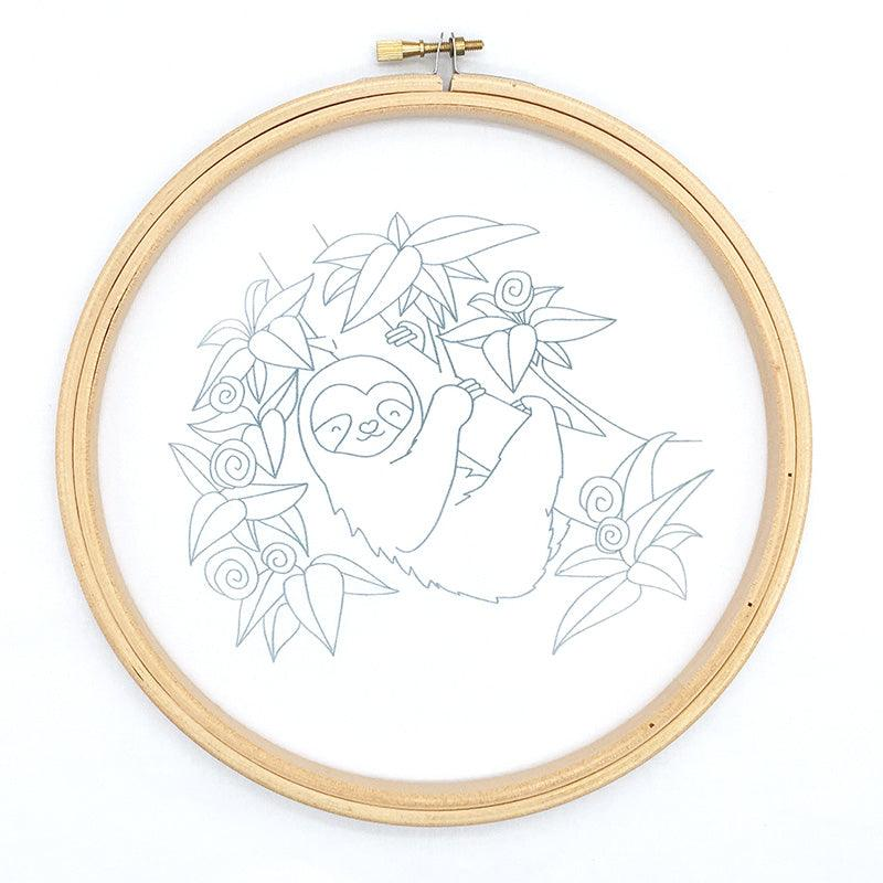 Embroidery pattern transferred to cotton fabric, embroidery design shows a sloth