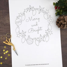 Load image into Gallery viewer, Iron on transfer for hand embroidery, this embroidery pattern features a Christmas Wreath Design with the words Merry and Bright